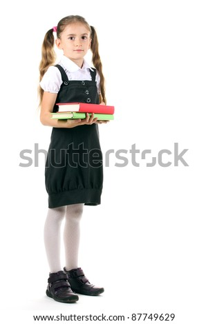 beautiful little girl in school uniform and books isolated on white - stock photo