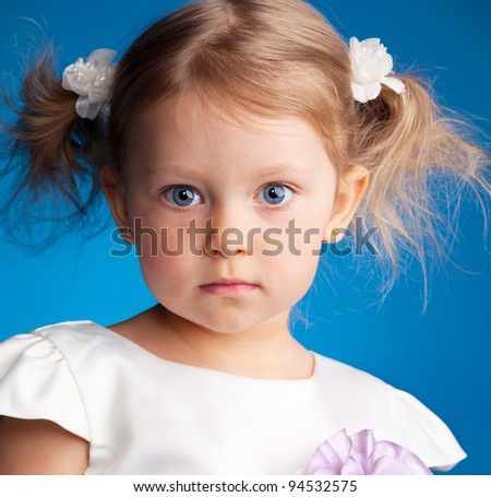 Beautiful little girl on a blue background