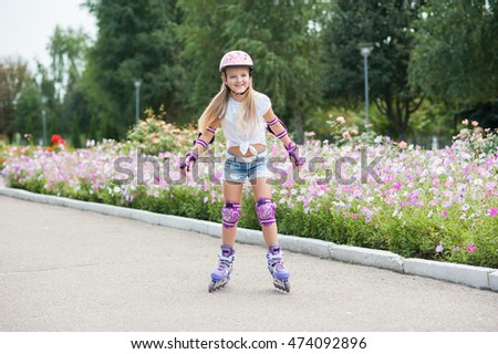 beautiful little girl on roller skates