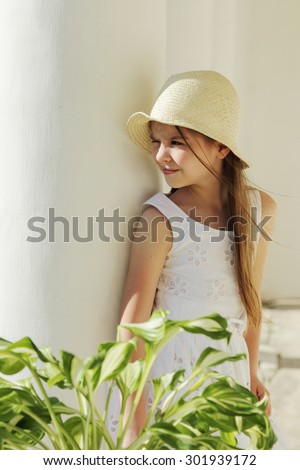 Beautiful little girl outdoor at summertime, Moscow region, Russia/Home land of russian poet M.Lermontov, homestead Serednikovo, Russia - stock photo