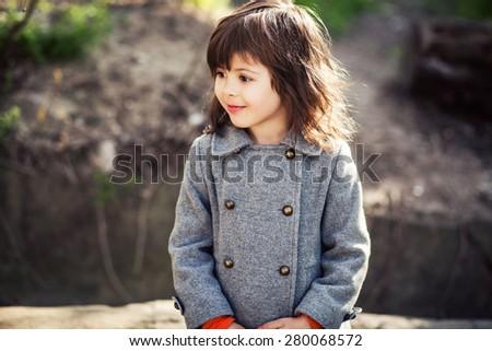 Beautiful little girl outdoors - stock photo