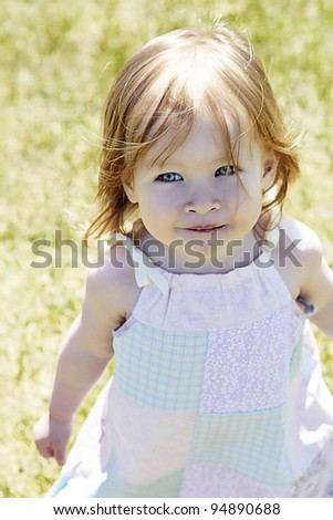 Beautiful Little Girl outside in summer with dress on