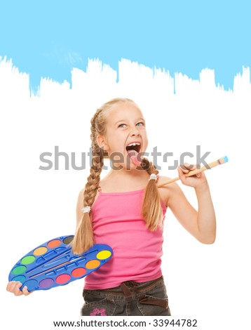 Beautiful little girl painting with blue paint - stock photo
