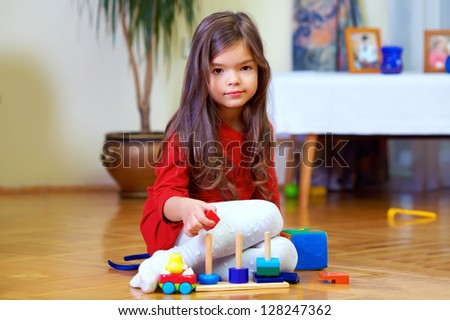 beautiful little girl playing toys at home - stock photo