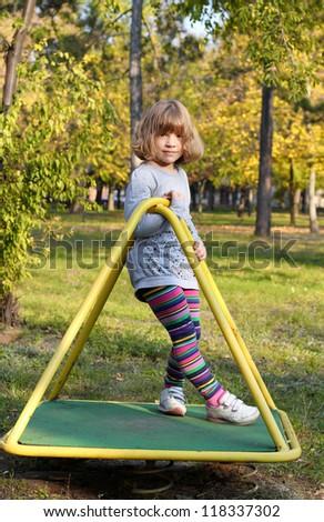beautiful little girl posing on playground - stock photo