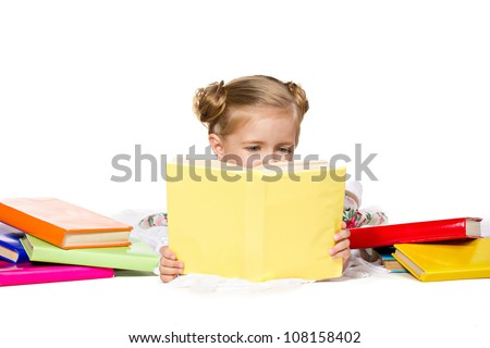 beautiful  little girl  reading the book, near - many multicolored books,  isolated on white - stock photo