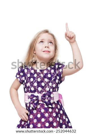 Beautiful little girl showing on something by finger isolated  - stock photo