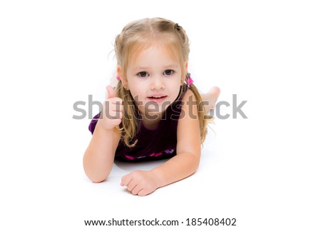 Beautiful little girl  shows finger as sign that everything is fine, isolated on white background.
