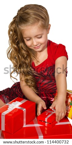 beautiful  little girl sitting and  looking presents in a box set isolated on white