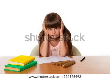 beautiful little girl tired of doing homework - stock photo