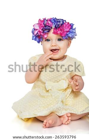 Beautiful little girl wearing a wreath - stock photo