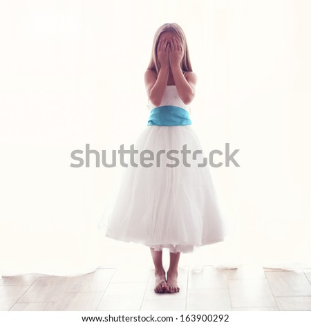 Beautiful little girl wearing fairy costume over white, image toned instagram style - stock photo