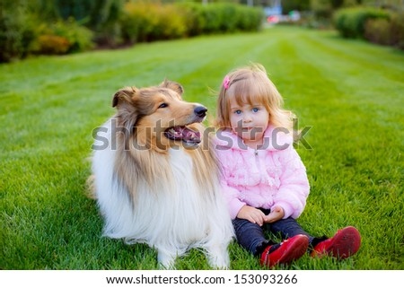 beautiful little girl with a beautiful collie dog