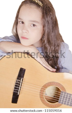 Beautiful little girl with a guitar (isolated on white) - stock photo