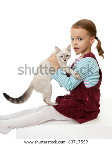 Beautiful little girl with a kitten. On the eastern calendar 2011 - the year the cat. - stock photo