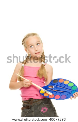 Beautiful little girl with a paintbrush, Isolated on white - stock photo