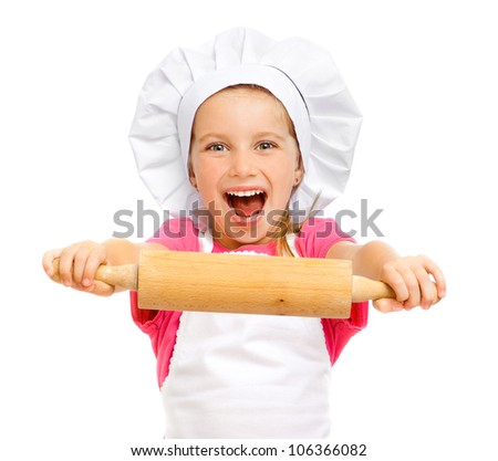 beautiful little girl with a rolling pin on a white background