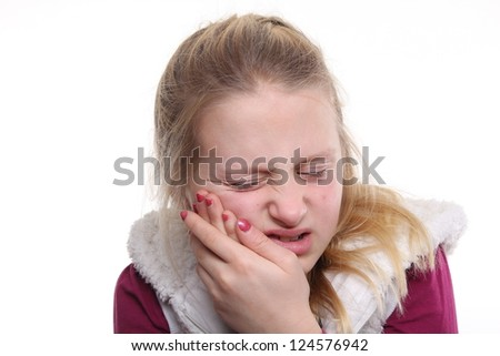 Beautiful little girl with a toothache - stock photo