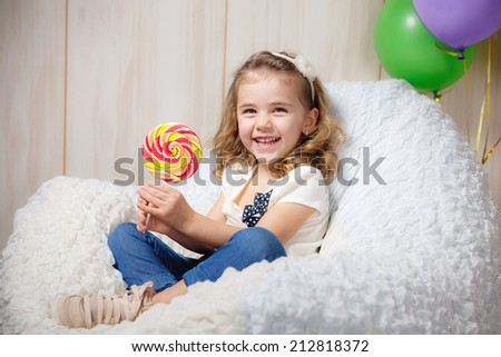 Beautiful little girl with balloons, emotions and holidays