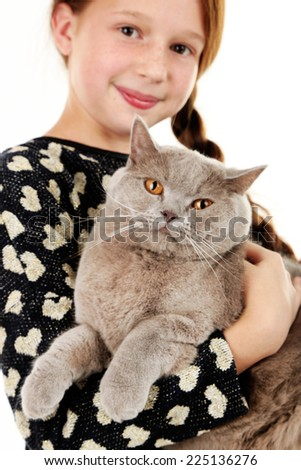 Beautiful little girl with cat close up - stock photo