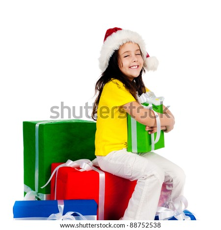beautiful little girl with gifts in santa hat