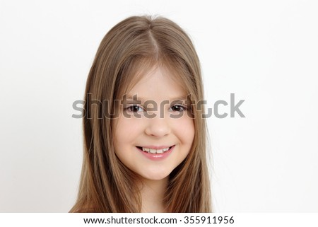 Beautiful little girl with gorgeous and healthy hair - stock photo