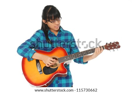Beautiful little girl with guitar on a white background