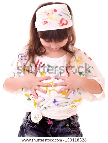 Beautiful little girl with hands in the color paint on white background