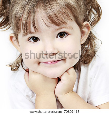 Beautiful little girl with hands on her chin taken closeup - stock photo