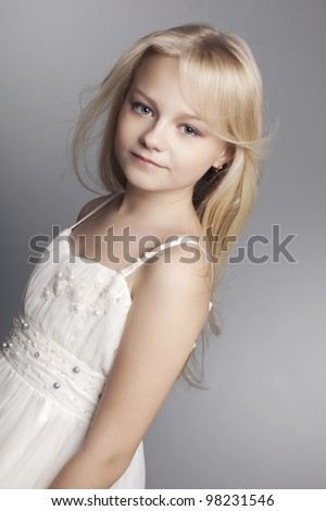 beautiful little girl with long hair blonde on a white background