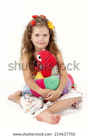 Beautiful little girl with plush toy - stock photo