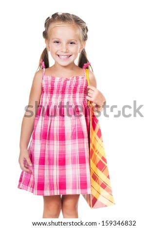 beautiful little girl with shopping bag isolated on white background - stock photo