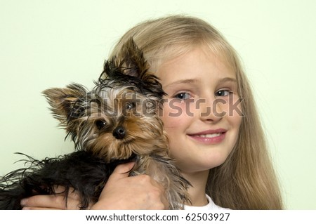Beautiful little girl with Yorkie pup