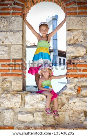 Beautiful little girls in ancient ruins of the Nesebar, the ancient city on the Black Sea coast of Bulgaria.