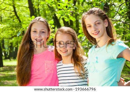Beautiful little girls in park - stock photo