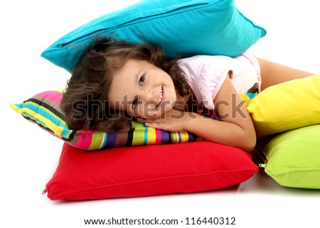 beautiful little girlwith pillows isolated on white