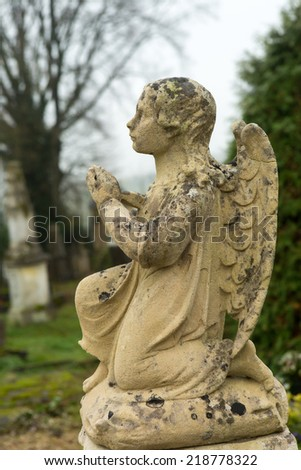 Beautiful little graveyard angel in a medieval French cemetery