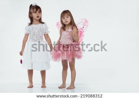 Beautiful little princess wearing fairy costume over white - stock photo