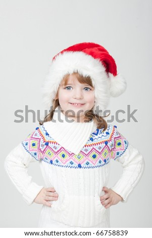 beautiful little smiling girl with blue eyes and Christmas cup - stock photo