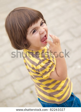 Beautiful little toddler girl shouting