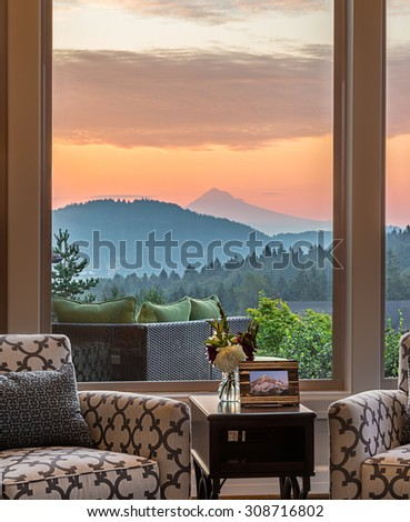 Beautiful Living Room Detail with Sunrise View - stock photo