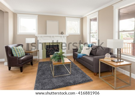 Beautiful living room interior with hardwood floors and fireplace in new home - stock photo