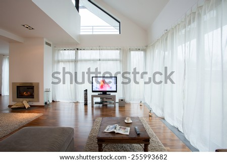Beautiful living room with fireplace in apartment - stock photo