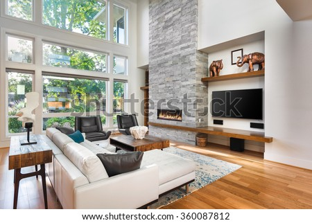Beautiful Living Room With Hardwood Floors And Fireplace In New Luxury Home Has Very Tall