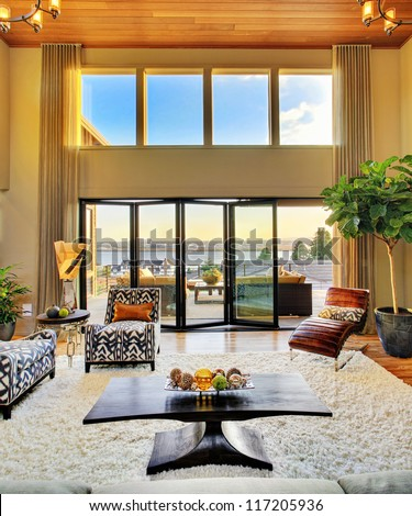 Beautiful Living Room with View in Luxury Home - stock photo