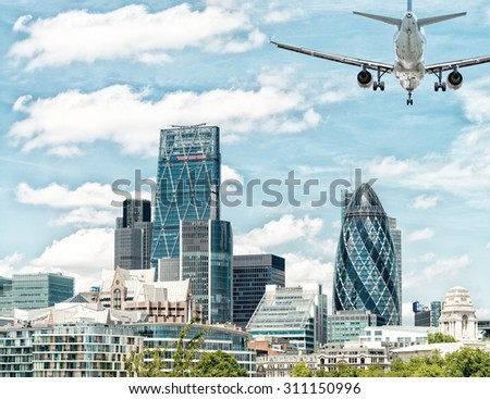 Beautiful London skyline with airplane in the sky. - stock photo