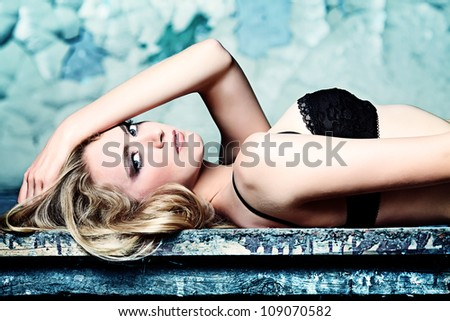 Beautiful lonely woman in the old house. - stock photo
