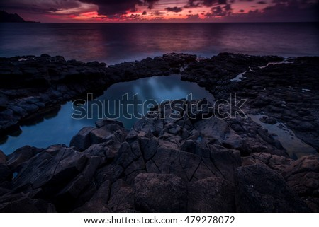 Beautiful long-exposure image of the Queensbath, a shoreline pool along the Princeville coast of the island of Kauai, Hawaii
