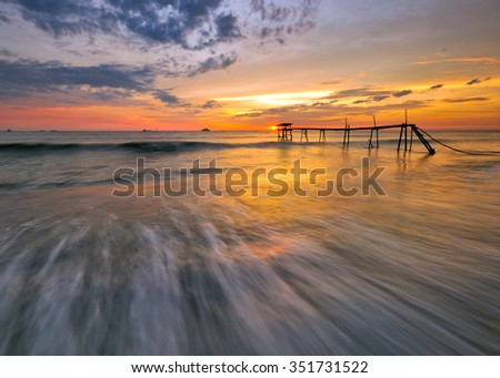 Beautiful long exposure shot of fishermen jetty at dusk. Soft focus due to long exposure shot. Vibrant colors. Composition of nature.
