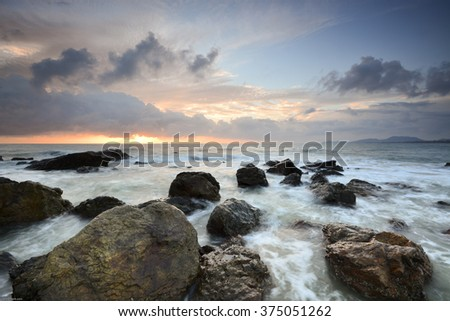 Beautiful long exposure shot of seascape at Terengganu, Malaysia. Soft focus due to long exposure shot at sunrise. Nature composition.